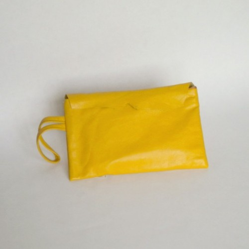 Yellow leather purse with flap