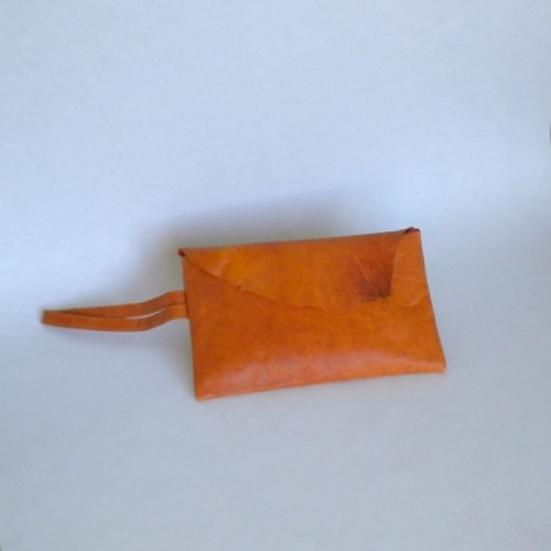 Orange leather clutch with flap