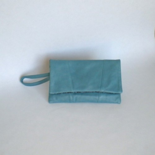 Blue leather clutch bag with panels
